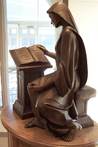 "Upon entering the library at Mount Marty College, one is greeted by this statue of St. Scholastica reading Psalm 95, ""If today you hear His voice, harden not your hearts."""