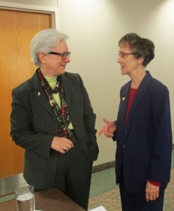S. Dawn Nothwehr (left) and S. Marielle Frigge chatting at Theology Institute held in Sacred Heart Monastery's Chapter Room.