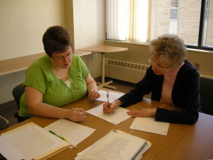 Sister Francine teaching calligraphy to, then, Novice Peggy